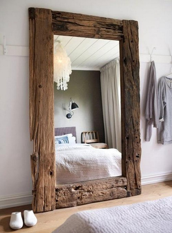 Add rustic mirror on the bedroom wall