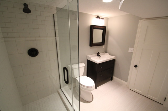 A bathroom with a white door Description generated with very high confidence